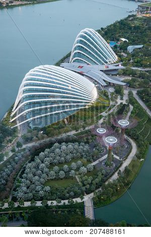 January 3 2017. Wide angle aerial view of the Gardens by the Bay with the Supertree Grove Greenhouses and Marina Bay visible in the evening. Vertical orientation Singapore. Travel editorial.
