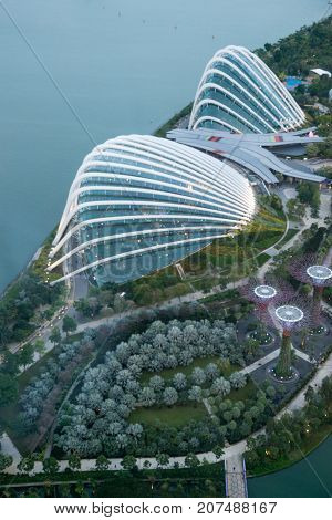 January 3 2017. Wide angle vertical aerial view of the Gardens by the Bay with the Supertree Grove Greenhouses and Marina Bay in the evening. Singapore. Travel and tourism editorial.