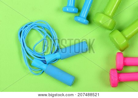 Dumbbells And Skipping Rope In Cyan Blue Color