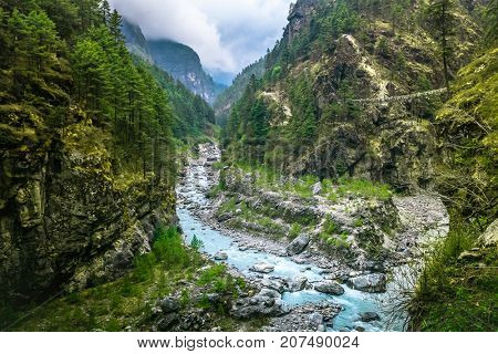 Mountain Canyon Valley. Beautiful river landscape and mountain forest in Nepal. Trekking route to Everest Base Camp, Himalayas. Holidays, recreation. Travel background. Beautiful nature landscape