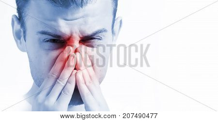 man with runny nose on white background in blue toning ill with laryngitis