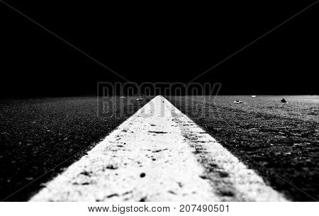 road line in the empty streets night black and white photo