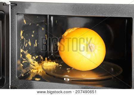 Exploded spaghetti squash in microwave