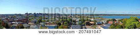Portland City Skyline and Back Cove panorama on Munjoy Hill in Portland, Maine, USA.