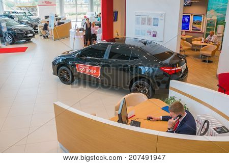 Manager And Car In Showroom Of Dealership Toyota In Kirov City In 2016