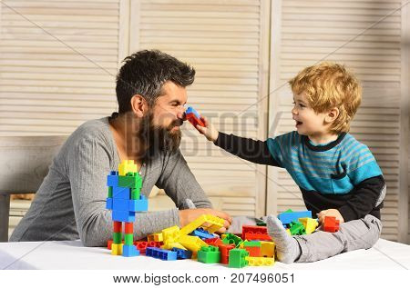Family And Childhood. Man With Beard And Boy Play Together