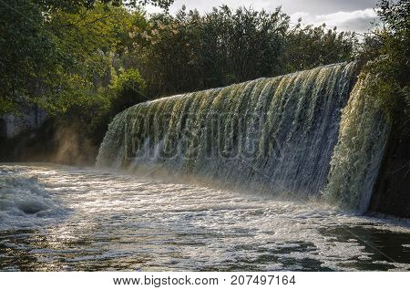 autumn beautiful waterfall in the afternoon in the village of Buki Cherkasy region Ukraine