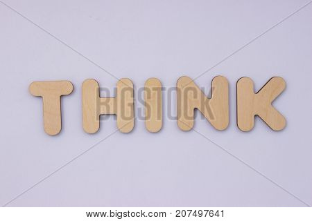 words from wooden letters on light grey background