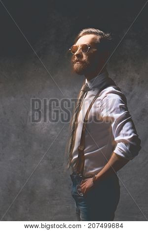 Portrait of a young man with beard in glasses shot in double exposure.