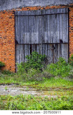 close-up of the gate of big brick barn in countryside