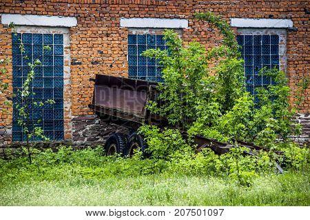 close-up wall of big brick barn in countryside