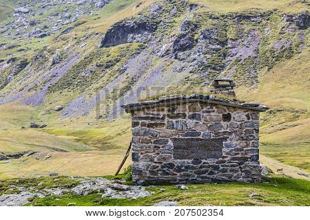 Remote stone shelter (Aires chalet) in the middle of the glacial cirque of Troumouse in Pyrenees Mountains France.