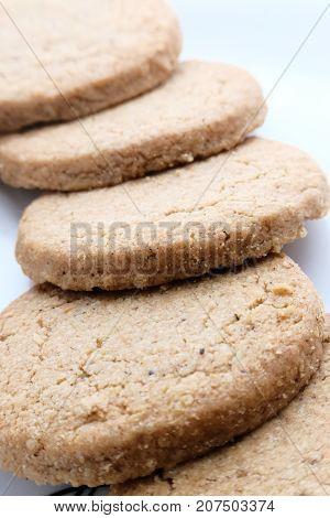 Oatmeal handmade cookies with honey on plate.