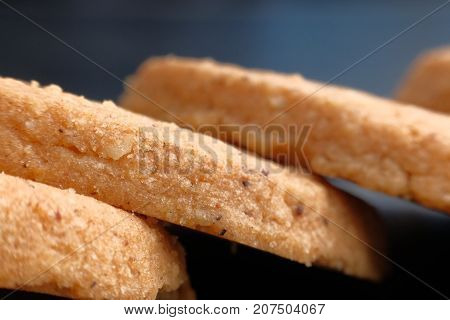 short pastry cookies isolated on black background.