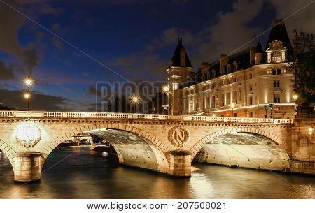 The pont Saint- Michel is a bridge linking the Place Saint-Michel on the left bank of the river Seine to the Ile de la Cite in Paris, France. The present 62-meter-long bridge dates to 1857.