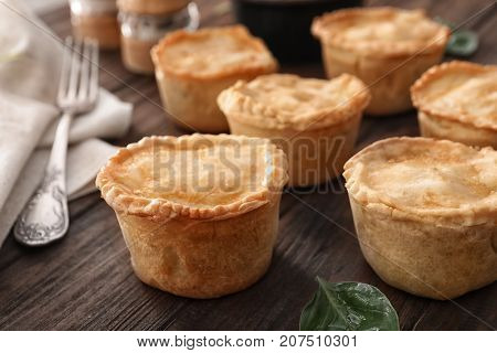 Delicious meat mini pies on table, closeup