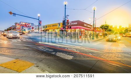 San Francisco, California, United States - August 14, 2016: sunset at Jefferson and  Jones roads crossroad. Motion blur traffic on the streets. Holidays, lifestyle and nigthlife concept.