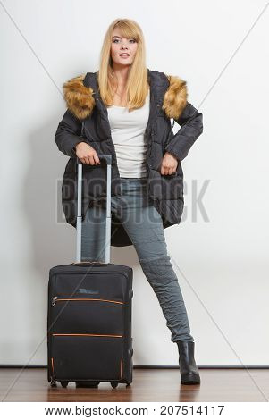 Young Woman In Warm Jacket With Suitcase.
