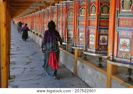 The Life Around Labrang In Xiahe, Amdo Tibet, China. Pilgrims Are Everywhere, Circumabulating The Mo