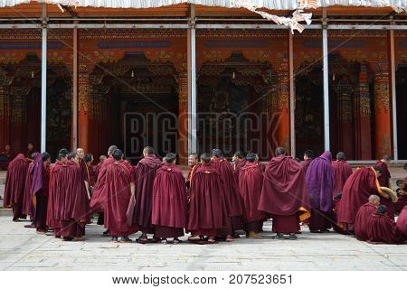The Life Around Kirti Gompa Monastery In Langmusi, Amdo Tibet, China. Monks Are Everywhere, As This