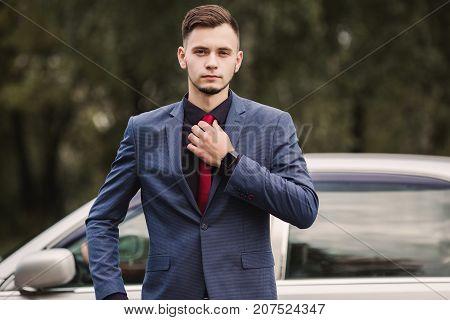 Successful business man professional in a dark business suit. Stylish man. A professional at work. Professional successful director. Luxury man
