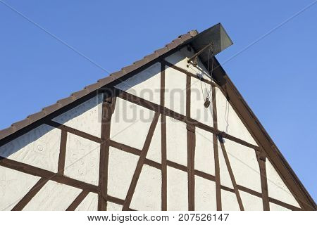 Historical half-timbered house with cable winch in hessen germany