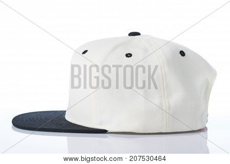 Profile view of white baseball cap isolated on white background