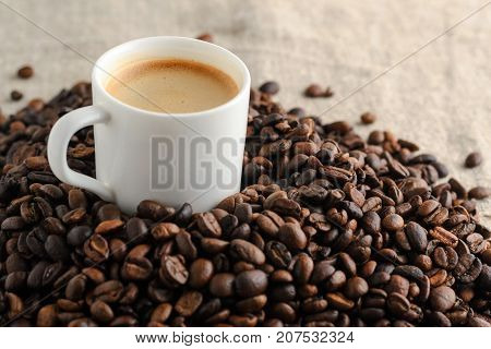 coffee cup espresso on background from cofee beans