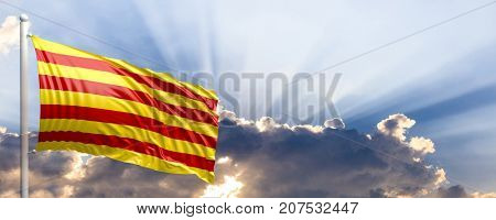 Catalonia waving flag on a blue sky. 3d illustration