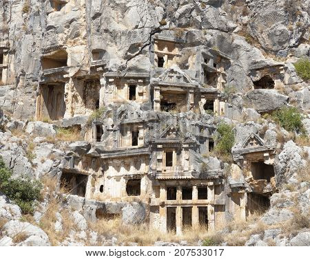 Demre;Turkey-September 08;2017: Myra was an ancient Greek town in Lycia.The tomb carved into the rocks the so-called necropolis.Tombs are located high above the ground.