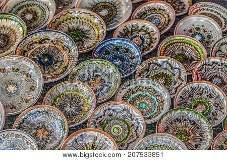 Romanian traditional ceramic in the plates form painted with specific patterns for Horezu area.