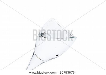 A water glass on white background isolated in backlight