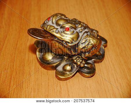A  three legged frog that brings financial success according feng shui