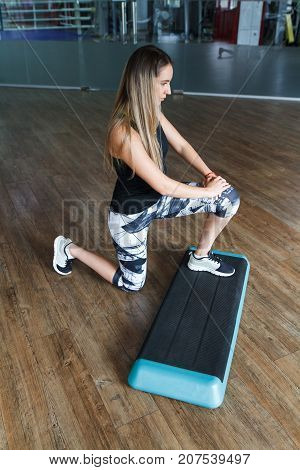 Girl In The Gym With A Shell Step