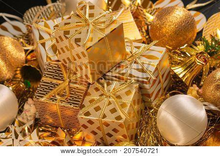 Luxury Gold Themed Holiday Greeting Card with Gift Boxes on Festive Background , Beautiful Christmas Design Template with Assorted Decorative Gifts and Baubles for Your Seasonal Greeting