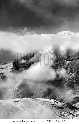 Black And White View On Ski Resort In Mist And Sunlight Sky Before Blizzard