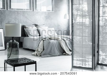 Screened Bedroom With Glass Lamp