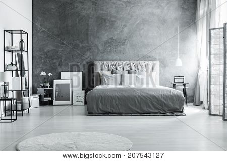Bed Against Dark Textured Wall
