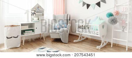 Armchair Next To Cradle