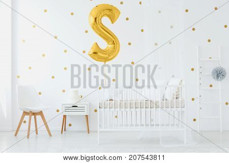 Gold Balloon Above Kid's Bed
