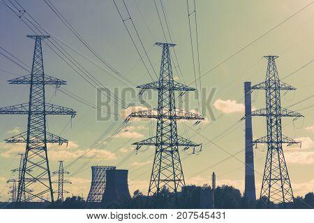 Power line technology voltage electricity pylon landscape.