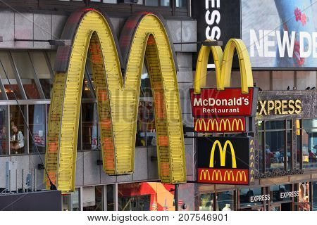 NEW YORK CITY - AUG. 24 : MacDonalds signs on the Times Square in Manhattan on August 24 2017 in New York City NY. Times Square is a major tourist destination and entertainment center.