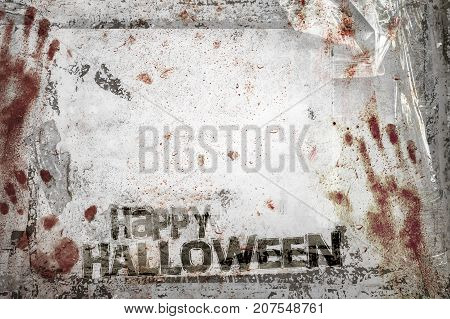 Happy Halloween background with grungy frame bloody handprints remains of scotch tape and cellophane. Vertical background fully editable.