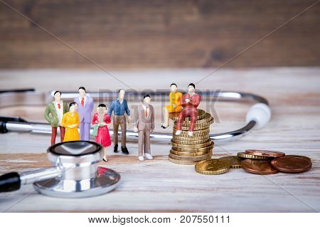 Medical care and expenses, health insurance. Colorful Human miniatures.