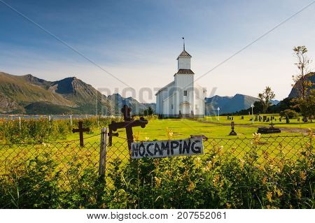 White church and small cemetery in Bardstrand GimsoysandLofoten islandsNordlandNorway