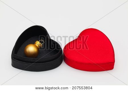 Christmas decoration in open velvet box on the white table