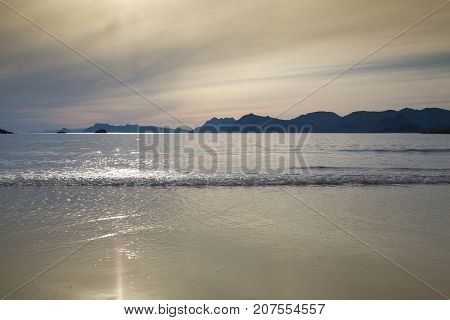 Sunset on the empty Roervik beach Lofoten island Norway