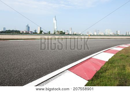empty asphalt road in modern circuit and cityscape of nanjing in blue cloud sky