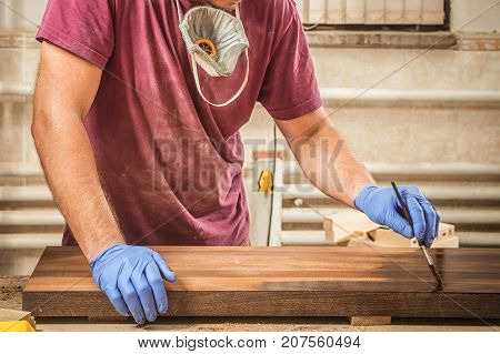 Man Paints A Wooden