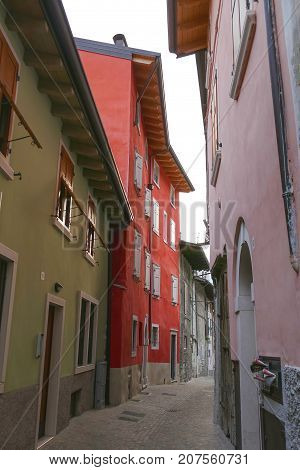 Old Red House In A Narrow Street In Italy
